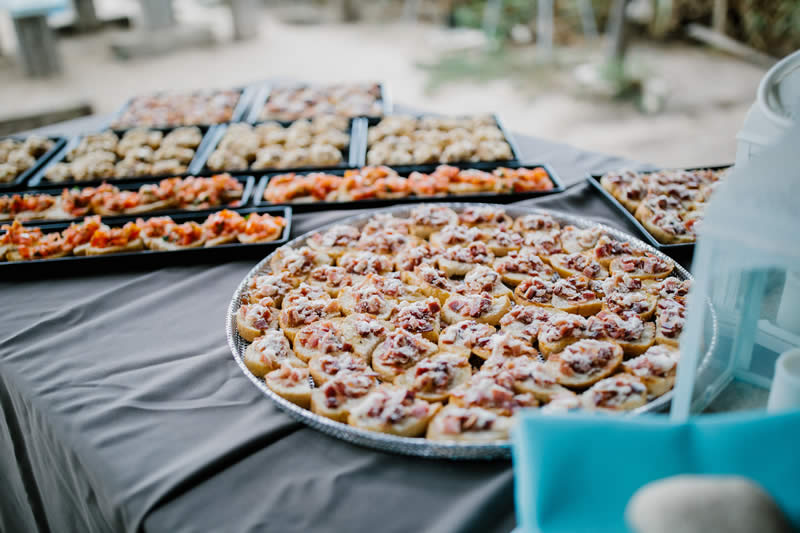 food served on platters, beach wedding